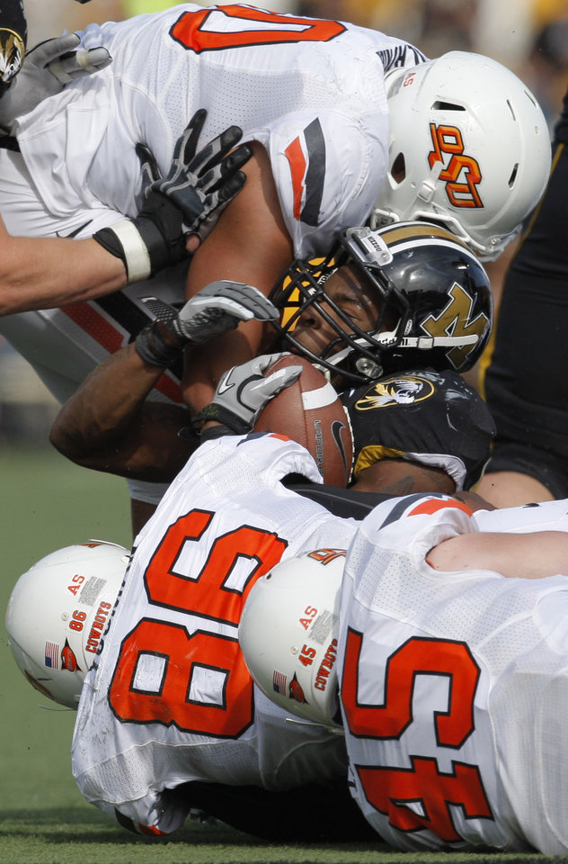 Photo - Oklahoma State's Jamie Blatnick (50,  Wilson Youman (86) and Caleb Lavey (45) tackle Missouri's Henry Josey (20) during a college football game between the Oklahoma State University Cowboys (OSU) and the University of Missouri Tigers (Mizzou) at Faurot Field in Columbia, Mo., Saturday, Oct. 22, 2011. Photo by Sarah Phipps, The Oklahoman