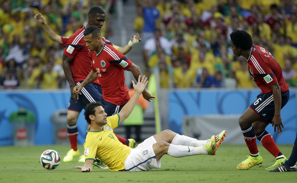 Photo - Brazil's Fred protests after being fouled during the World Cup quarterfinal soccer match between Brazil and Colombia at the Arena Castelao in Fortaleza, Brazil, Friday, July 4, 2014. (AP Photo/Hassan Ammar)
