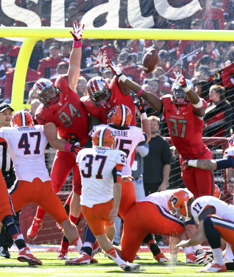 Photo -   Rutgers' Jamal Merrell gets his hand on the ball for the block of a field-goal attempt by Syracuse's Ross Krautman (37) during the second half of an NCAA college football game in Piscataway, N.J., on Saturday, Oct. 13, 2012. (AP Photo/Home News Tribune, Mark R. Sullivan) NO SALES NEWARK STAR-LEDGER OUT