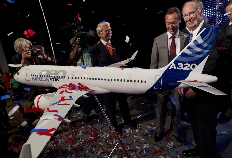 Photo - Alabama Gov. Robert Bentley, right, and Airbus President and CEO Fabrice Bregier celebrate Monday the announcement that Airbus will establish its first assembly plant in the United States in Mobile, Ala.   AP Photo