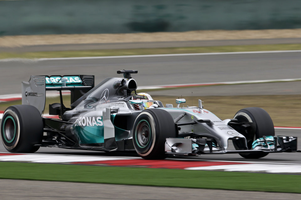 Photo - Mercedes driver Lewis Hamilton of Britain steers his car during a practice session ahead of Sunday's Chinese Formula One Grand Prix at Shanghai International Circuit in Shanghai, China, Friday, April 18, 2014. (AP Photo/Alexander F. Yuan)