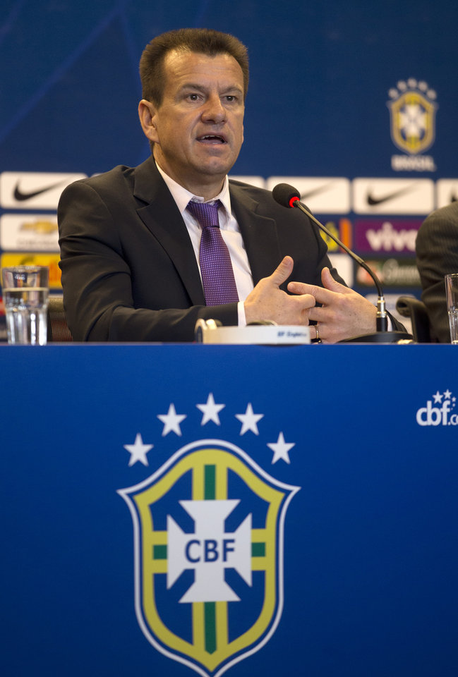 Photo - Brazil's soccer coach Dunga speaks during a press conference in Rio de Janeiro, Brazil, Tuesday, Aug. 19, 2014. Dunga summoned players for upcoming friendly games against Colombia and Ecuador, the first time he picked players since taking over the national team from Luiz Felipe Scolari after the World Cup. (AP Photo/Silvia Izquierdo)