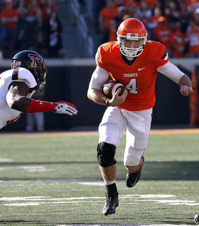 Photo - Oklahoma State's J.W. Walsh (4) rushes during a college football game between Oklahoma State University and the Texas Tech University (TTU) at Boone Pickens Stadium in Stillwater, Okla., Saturday, Nov. 17, 2012. Photo by Sarah Phipps, The Oklahoman