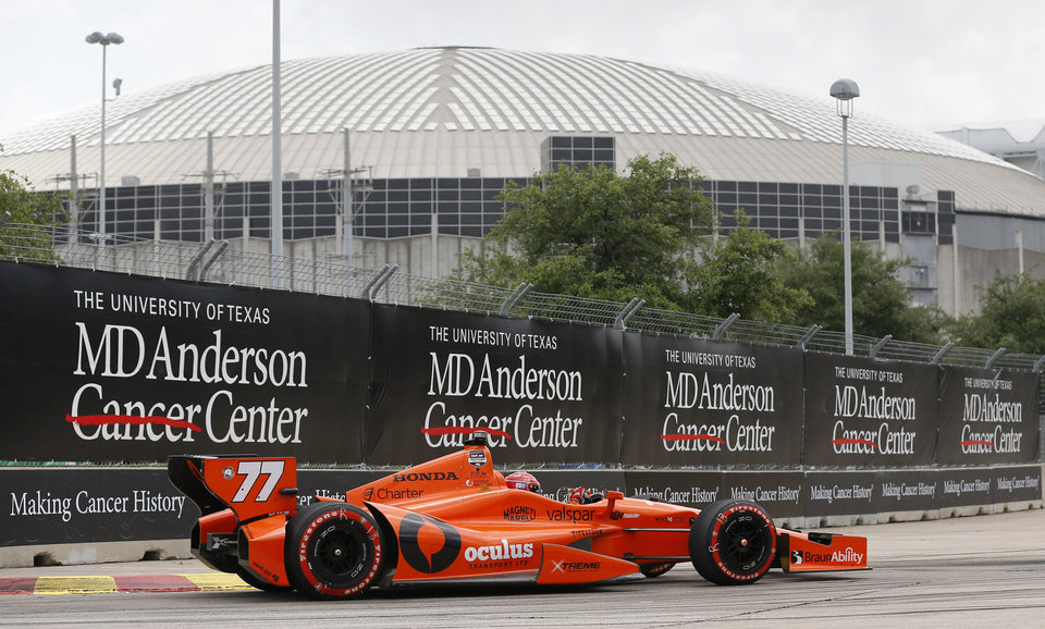 Photo - Simon Pagenaud, of France, comes out of Turn 3 near the Astrodome during the second IndyCar Grand Prix of Houston auto race Sunday, June 29, 2014, in Houston. (AP Photo/David J. Phillip)
