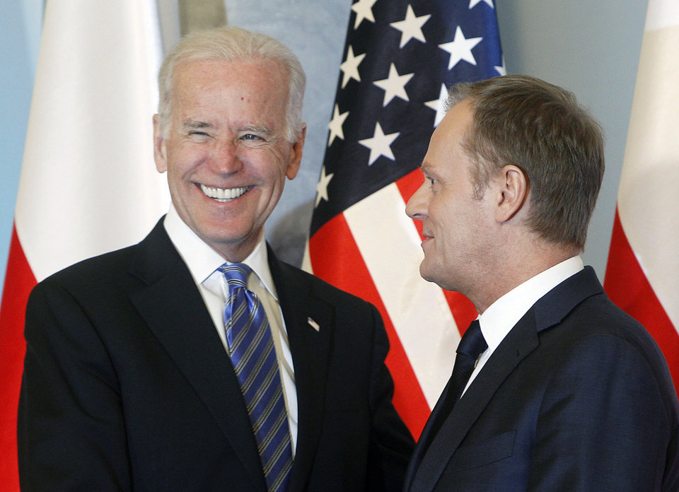 Photo - U.S. Vice President Joe Biden, left, and Poland's Prime Minister Donald Tusk, right, pose for media before heading for talks on Eastern Europe's security, in Warsaw, Poland, on Tuesday, March 18, 2014.  Biden is in Poland on a trip designed to show U.S. resolve against Russia's intervention in Ukraine. Poland borders both Russia and Ukraine. Later Tuesday Biden will also meet with Poland's President Bronislaw Komorowski and with Estonian President Toomas Hendrik Ilves. The meetings with the NATO allies are part of a broader U.S. campaign to persuade Russian President Vladimir Putin to back off in Ukraine. (AP Photo/Czarek Sokolowski)