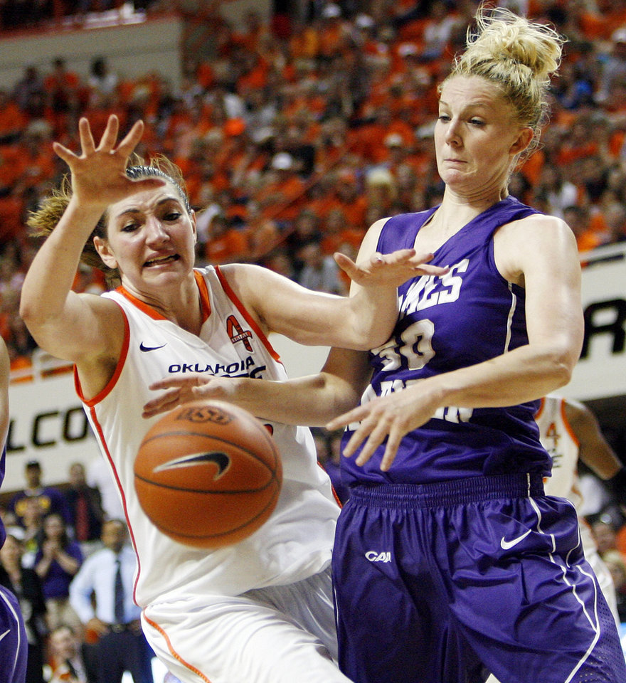Photo - OSU's Lindsey Keller (25) and James Madison's Nikki Newman (30) battle for the ball during the Women's NIT championship college basketball game between Oklahoma State University and James Madison at Gallagher-Iba Arena in Stillwater, Okla., Saturday, March 31, 2012. OSU won, 75-68. Photo by Nate Billings, The Oklahoman