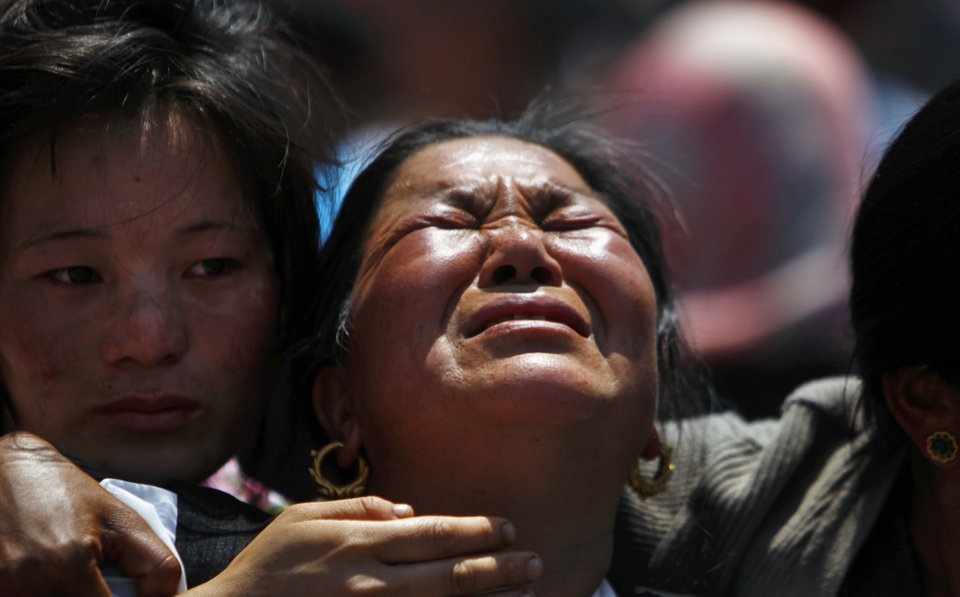 Photo - Relatives of mountaineers, killed in an avalanche on Mount Everest, cry during the funeral ceremony in Katmandu, Nepal, Monday, April 21, 2014. Buddhist monks cremated the remains of Sherpa guides who were buried in the deadliest avalanche ever recorded on Mount Everest, a disaster that has prompted calls for a climbing boycott by Nepal's ethnic Sherpa community. The avalanche killed at least 13 Sherpas. Three other Sherpas remain missing and are presumed dead. (AP Photo/Niranjan Shrestha)