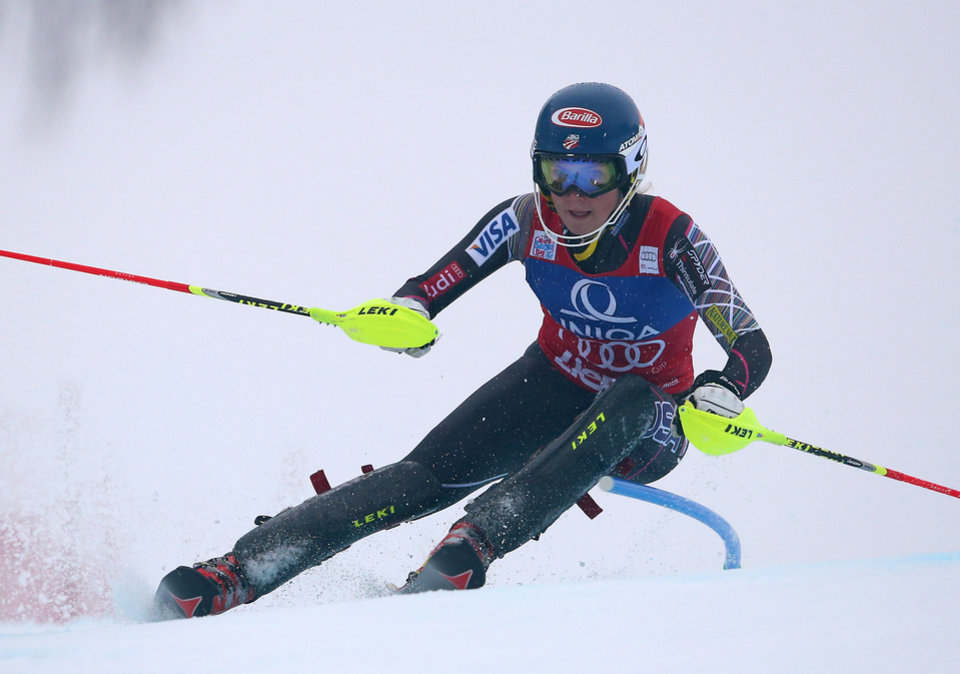 Photo - ADVANCE FOR WEEKEND OF JAN. 11-12 - FILE - Mikaela Shiffrin, of the United States, speeds down the course to set the fastest time during the first run of an alpine skiing women's World Cup slalom  in Lienz, Austria. The 18-year-old Shiffrin could very well be the face of the Sochi Olympics, especially now that Lindsey Vonn is out with a knee injury. (AP Photo/Giovanni Auletta)