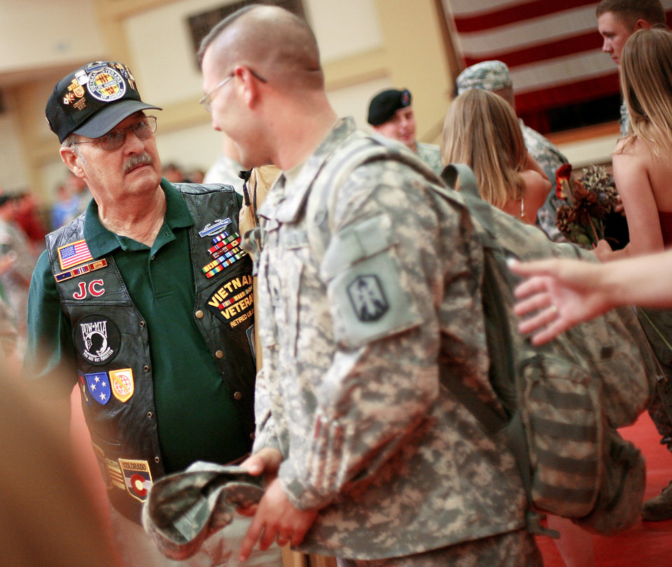 J.C. Humphries, a Vietnam veteran, welcomes soldiers home Tuesday at Fort Sill during a ceremony for  servicemembers returning from Iraq. Members of the Vietnam Veterans of America Chapter 751 have been  to every deployment and return since Sept. 11, 2001. Photos by John Clanton, The Oklahoman