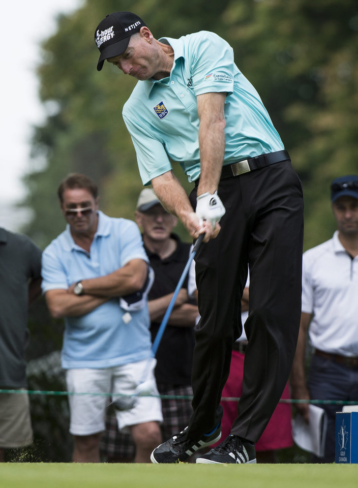 Photo - Jim Furyk hit off the 15th tee during second round play at the Canadian Open golf championship Friday, July 25, 2014 in Montreal. (AP Photo/The Canadian Press, Paul Chiasson)