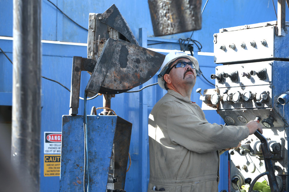 Driller Tim Lovell works the pipe from the Drillers console on a SandRidge oil drilling rig near Medford, Thursday, October 18, 2012. This is for Oklahoma Inc. Photo By David McDaniel/The Oklahoman