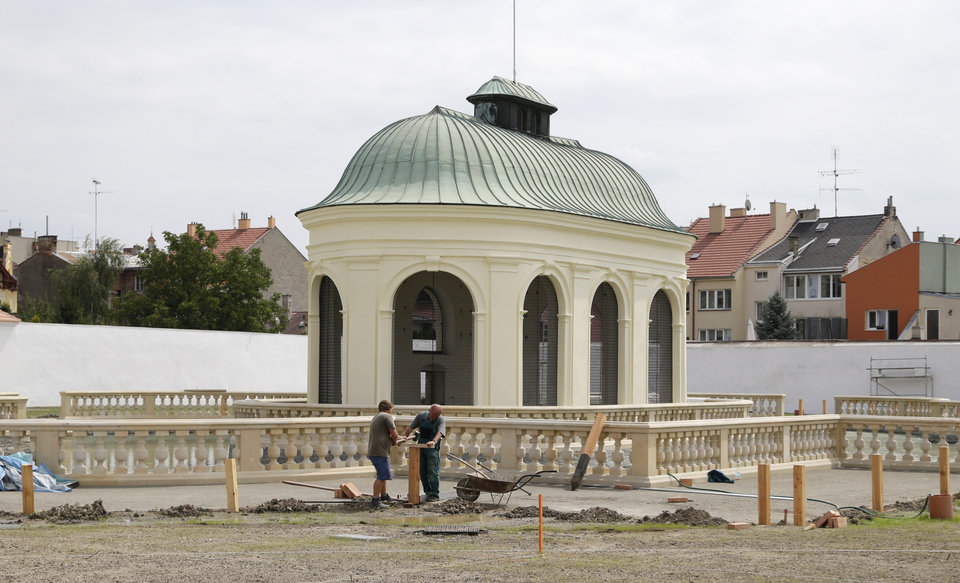 Photo - In this Aug. 7, 2014, photo workers hammer in a post during renovations of UNESCO's Flower Garden in city of Kromeriz, in Czech Republic. Restoration efforts began in the 1950s, and the Flower Garden was added to UNESCO's World Heritage list in 1998 together with the castle and another garden on the grounds. The European Union is now funding restoration of about a third of the Flower Garden, using copper engravings from 1691 as a guide for what it once looked like. (AP Photo/Petr David Josek)
