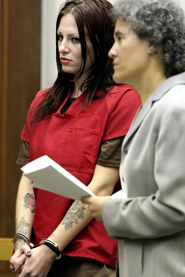 Photo - Alix Tichelman, left, 26, of Folsom, Calif., stands with public defender Diane August during her arraignment in Santa Cruz Superior Court on Wednesday, July 9, 2014, in Santa Cruz, Calif. Tichelman is facing manslaughter charges for the November 2013 death of Forrest Hayes, a Google executive. A Silicon Valley success story turned sordid this week with the arrest of an upscale prostitute who allegedly left Hayes dying on his yacht after shooting him up with a deadly hit of heroin. Hayes, 51, was found dead by the captain of his 50-foot yacht Escape. (AP Photo/Santa Cruz Sentinel, Shmuel Thaler)