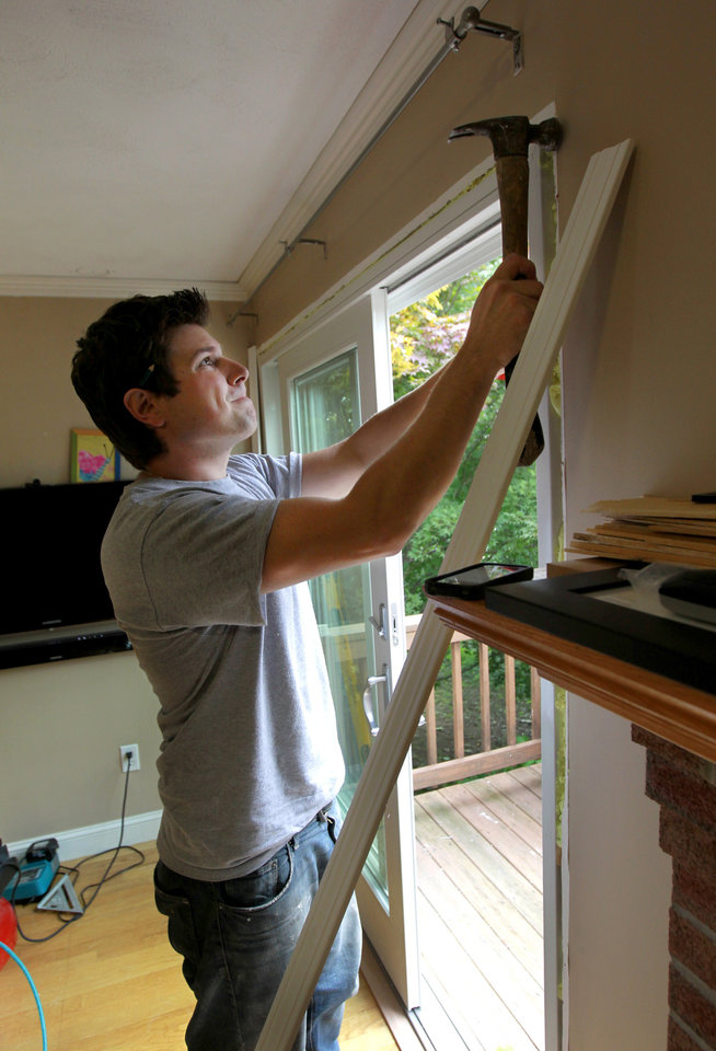 In this Monday, Oct. 1, 2012 photo carpenter Nick Rossi, of Newton, Mass., a contractor who does home remodeling and renovations, uses a hammer while completing a door installation at a home in Watertown, Mass. Sales of previously occupied homes are up more than 9 percent this year, and spending on residential construction has risen 16 percent. People who track housing trends see signs that remodeling is on the rise, and that the improvement will continue. Some of the uptick is coming from new homeowners fixing up and some is coming from people who put off work during the recession. (AP Photo/Steven Senne)