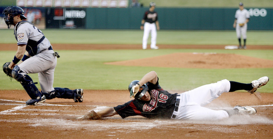 Sacramento's Chris Denorfia slides past Scranton's Chris Stewart to score in the second inning of the Triple-A Championship game at the AT&T Bricktown Ballpark in Oklahoma City, Tuesday, September 16, 2008. BY BRYAN TERRY, THE OKLAHOMAN