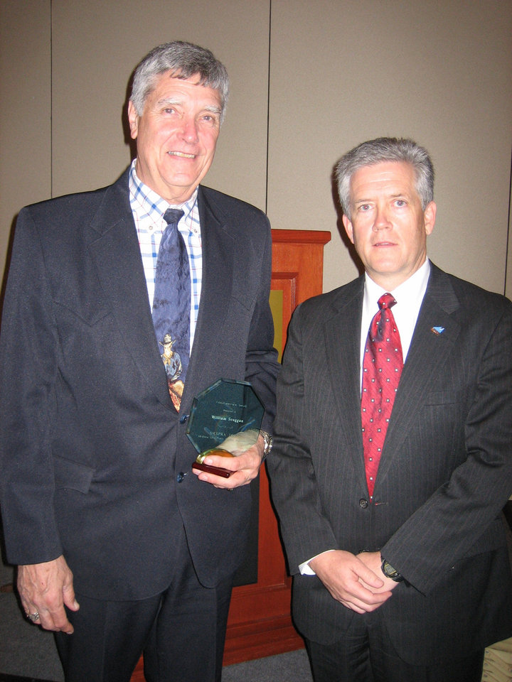 Bill Scoggan, Mid-Del Schools Superintendent, was the recipient of the Oklahoma School Public Relations Association Administrators Award at the OKSPRA annual conference. Mr. Ken Koch, President-Elect of OKSPRA, presented the award to Scoggan during the awards banquet.<br/><b>Community Photo By:</b> Stacey Boyer<br/><b>Submitted By:</b> Stacey, Midwest City