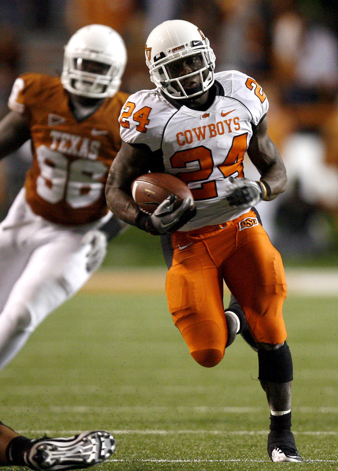 Photo - Oklahoma State's Kendall Hunter (24) run upfield as he is chased by Texas' Cade McCrary (86) during the college football game between the Oklahoma State University Cowboys (OSU) and the University of Texas Longhorns (UT) at Darrell K Royal-Texas Memorial Stadium in Austin, Texas, Saturday, November 13, 2010. Photo by Sarah Phipps, The Oklahoman