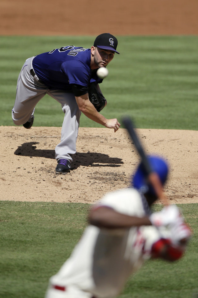 Photo -   Colorado Rockies' Tyler Chatwood pitches against Philadelphia Phillies' John Mayberry Jr. in the first inning of the first game of a baseball doubleheader on Sunday, Sept. 9, 2012, in Philadelphia. (AP Photo/Matt Slocum)