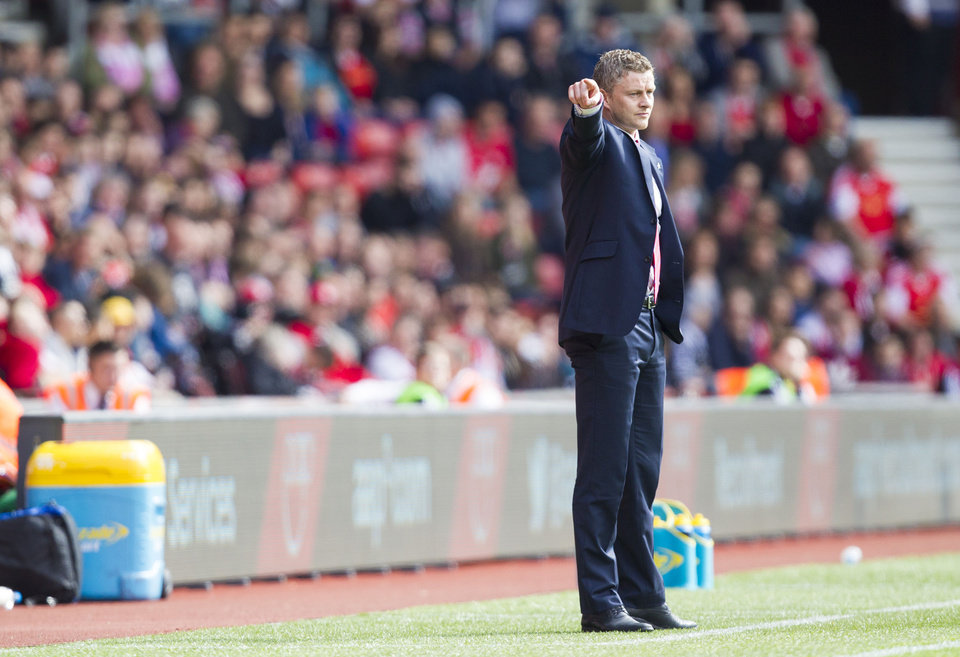 Photo - Cardiff City manager Ole Gunnar Solskjaer directs from the sidelines during the English Premier League soccer match between Cardiff City and Southampton at St Mary's, Southampton, England, Saturday, April 12, 2014. (AP Photo/Chris Ison, PA Wire)     UNITED KINGDOM OUT    -   NO SALES   -   NO ARCHIVES