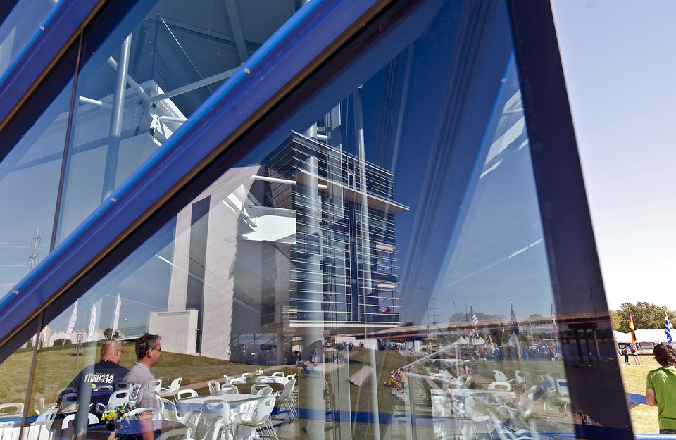 The Chesapeake finish line tower reflects in the glass of the Devon Boathouse during the Oklahoma Regatta Festival at the Oklahoma River on Saturday, Oct. 1, 2011, in Oklahoma City, Okla. Photo by Chris Landsberger, The Oklahoman