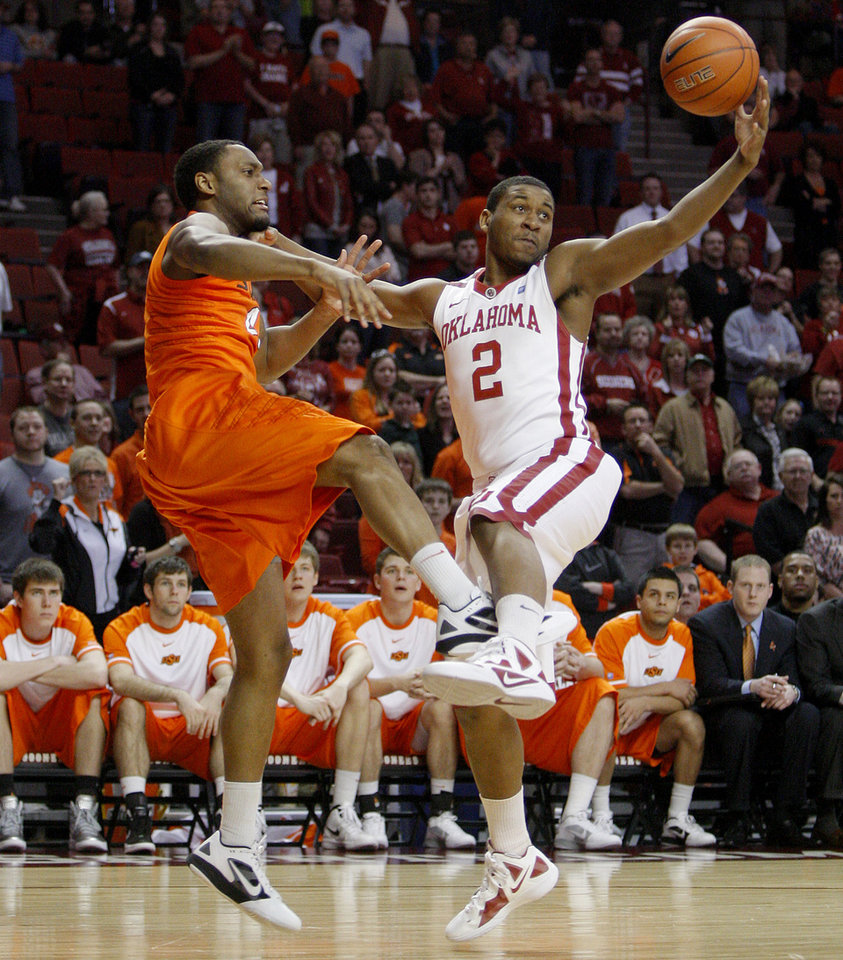 Oklahoma's Steven Pledger (2) gains control of the ball beside Oklahoma State's Brian Williams (4) during the Bedlam men's college basketball game between the University of Oklahoma Sooners and the Oklahoma State Cowboys in Norman, Okla., Wednesday, Feb. 22, 2012. Photo by Bryan Terry, The Oklahoman