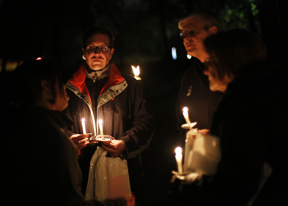 Madinah Hazim-Adams, Dan Adams, Jim Orsi, and Karen Orsi, gather Sunday during a candlelight vigil in Edmond to start Mental Illness Awareness Week.  Photos by Garett Fisbeck, The Oklahoman