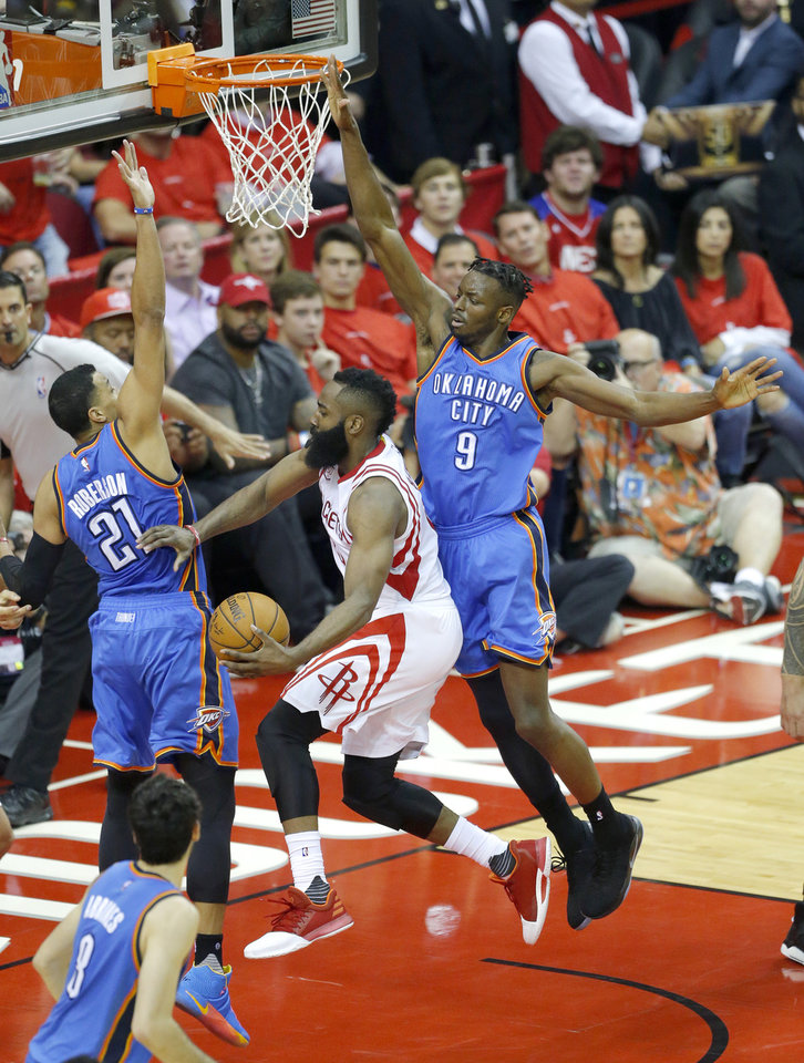 Photo - Houston's James Harden (13) shoots a lay up as Oklahoma City's Andre Roberson (21) and Jerami Grant (9) defend during Game 5 in the first round of the NBA playoffs between the Oklahoma City Thunder and the Houston Rockets in Houston, Texas,  Tuesday, April 25, 2017.  Houston won 105-99. Photo by Sarah Phipps, The Oklahoman