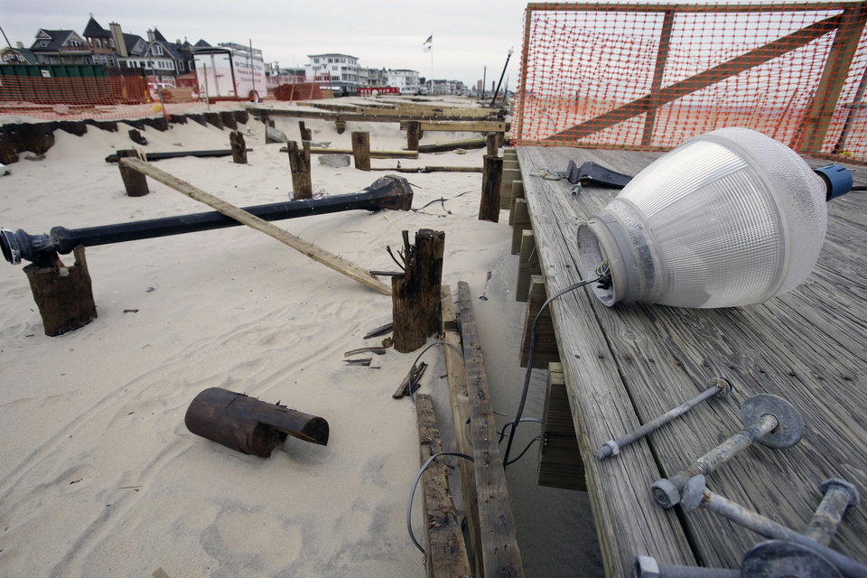 Broken lamps and the remains of the boardwalk that was destroyed by Superstorm Sandy is seen Thursday, Feb. 7, 2013, in the Ocean Grove section of Neptune, N.J. Officials plan to appeal the Federal Emergency Management Agency's decision to reject a request for $1 million to repair the Ocean Grove boardwalk, which was destroyed by Superstorm Sandy. FEMA says the structure doesn't qualify because it is owned by the private, nonprofit Ocean Grove Camp Meeting Association. (AP Photo/Mel Evans)