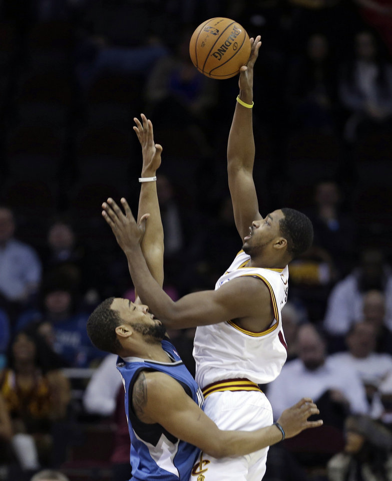 Cleveland Cavaliers' Tristan Thompson, right, shoots over Minnesota Timberwolves' Derrick Williams (7) during the first quarter of an NBA basketball game Monday, Feb. 11, 2013, in Cleveland. (AP Photo/Tony Dejak)