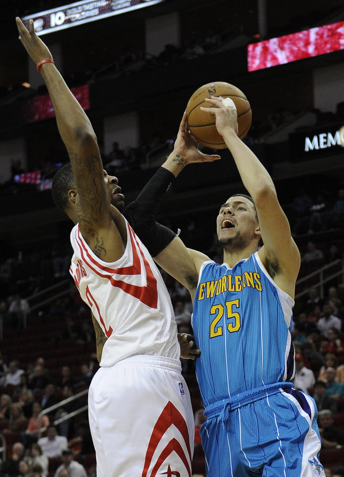 New Orleans Hornets' Austin Rivers (25) goes up against Houston Rockets' Marcus Morris (2) in the first half of an NBA basketball game, Wednesday, Nov. 14, 2012, in Houston. (AP Photo/Pat Sullivan)