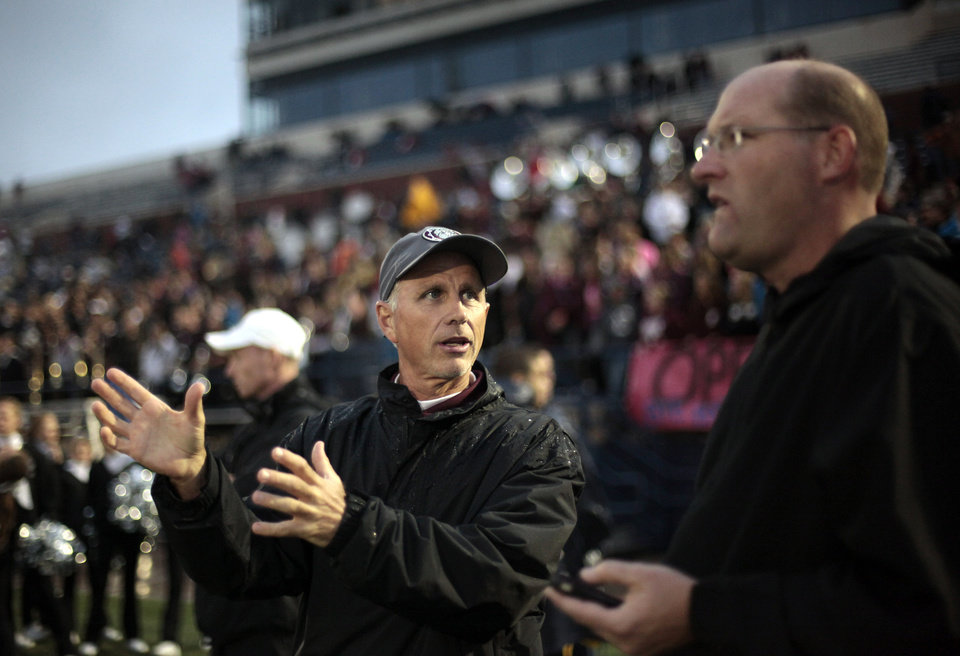 Edmond Memorial High School athletic director talks with Edmond Public Schools' Athletic Director Mike Nunley  during a Memorial football game Thursday, Sept.  13, 2012. Photo by Sarah Phipps, The Oklahoman