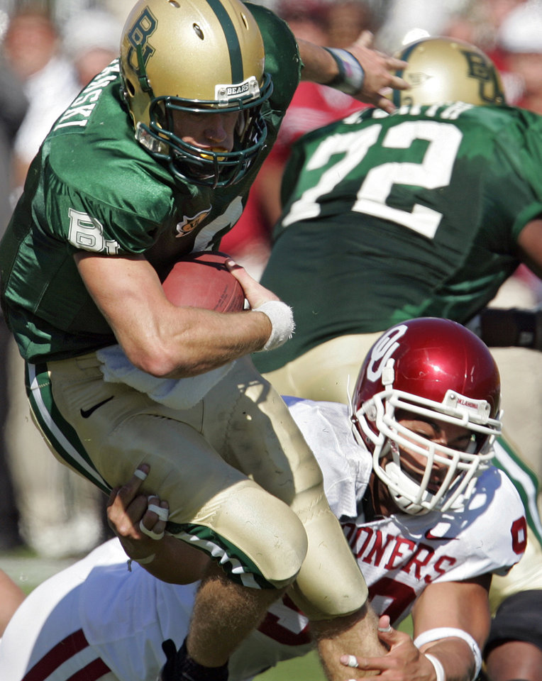 Photo - Oklahoma's C.J. Ah You (99) sacks Baylor quarterback Blake Szymanski (6) in the first half during the University of Oklahoma Sooners (OU) college football game against Baylor University Bears (BU) at Floyd Casey Stadium, on Saturday, Nov. 18, 2006, in Waco, Texas.     by Chris Landsberger, The Oklahoman
