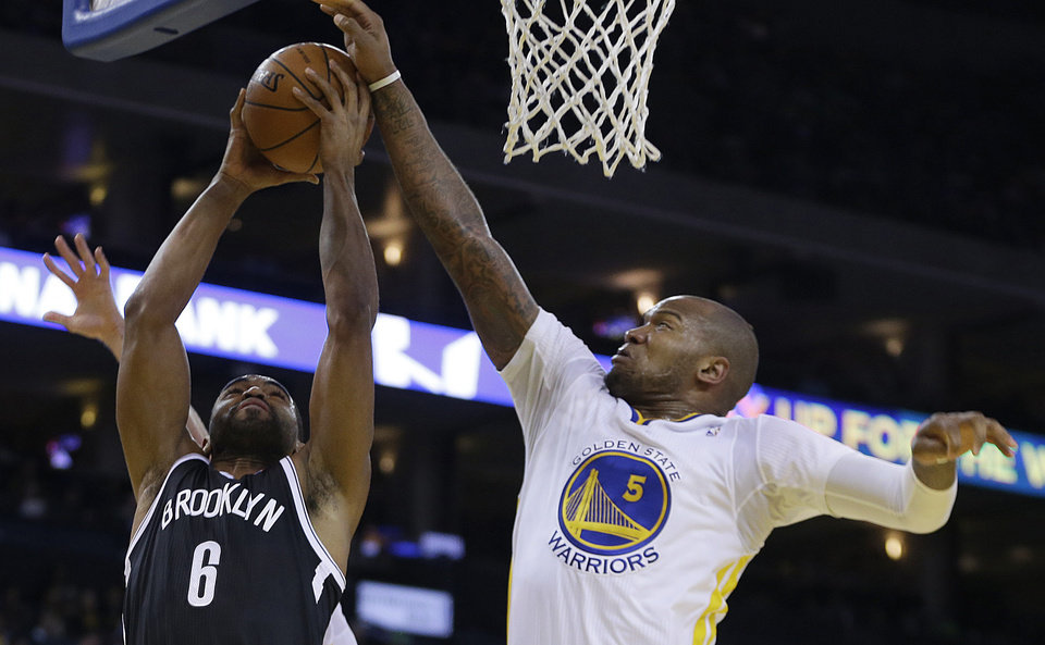 Brooklyn Nets\' Alan Anderson (6) shoots against Golden State Warriors\' Marreese Speights during the first half of an NBA basketball game Saturday, Feb. 22, 2014, in Oakland, Calif. (AP Photo/Ben Margot)