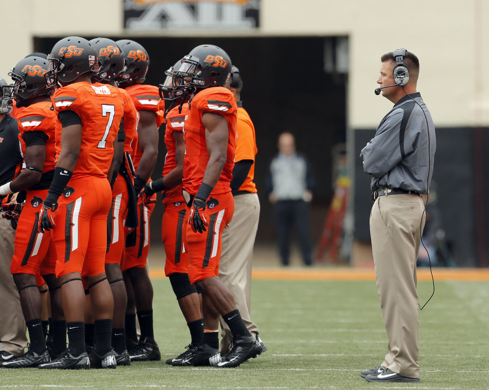 Photo - OSU head coach Mike Gundy is pictured during a timeout during a college football game between Oklahoma State University (OSU) and the University of Louisiana-Lafayette (ULL) at Boone Pickens Stadium in Stillwater, Okla., Saturday, Sept. 15, 2012. Photo by Sarah Phipps, The Oklahoman