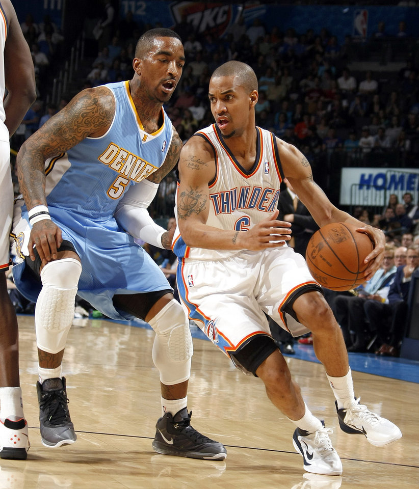 Photo - Oklahoma City's Eric Maynor (6) tries to drive past Denver's J.R. Smith (5) during the NBA basketball game between the Oklahoma City Thunder and the Denver Nuggets, Friday, April 8, 2011, at the Oklahoma City Arena.. Photo by Sarah Phipps, The Oklahoman