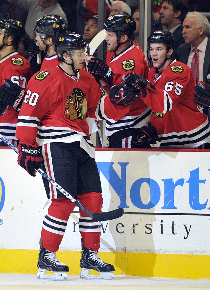 Photo - Chicago Blackhawks' Brandon Saad (20) is congratulated by Andrew Shaw after scoring a goal against the Nashville Predators during the first period of an NHL hockey game Friday, April 19, 2013, in Chicago. (AP Photo/Jim Prisching)