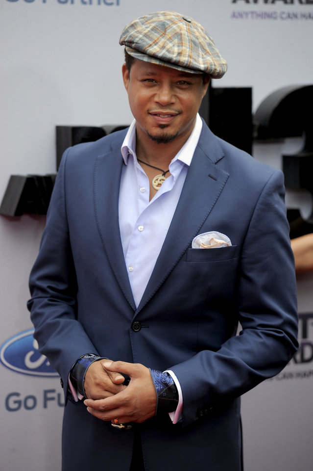 Terrence Howard arrives at the BET Awards at the Nokia Theatre on Sunday, June 30, 2013, in Los Angeles. (Photo by Chris Pizzello/Invision/AP)