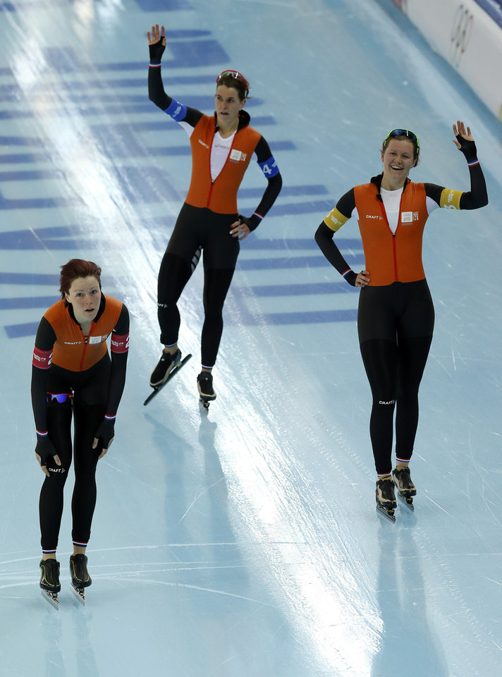 Photo - Speedskaters from the Netherlands Jorien ter Mors, Ireen Wust and Lotte van Beek, from left to right, acknowledge the crowd after competing in the women's speedskating team pursuit quarterfinals at the Adler Arena Skating Center during the 2014 Winter Olympics in Sochi, Russia, Friday, Feb. 21, 2014. (AP Photo/Patrick Semansky)