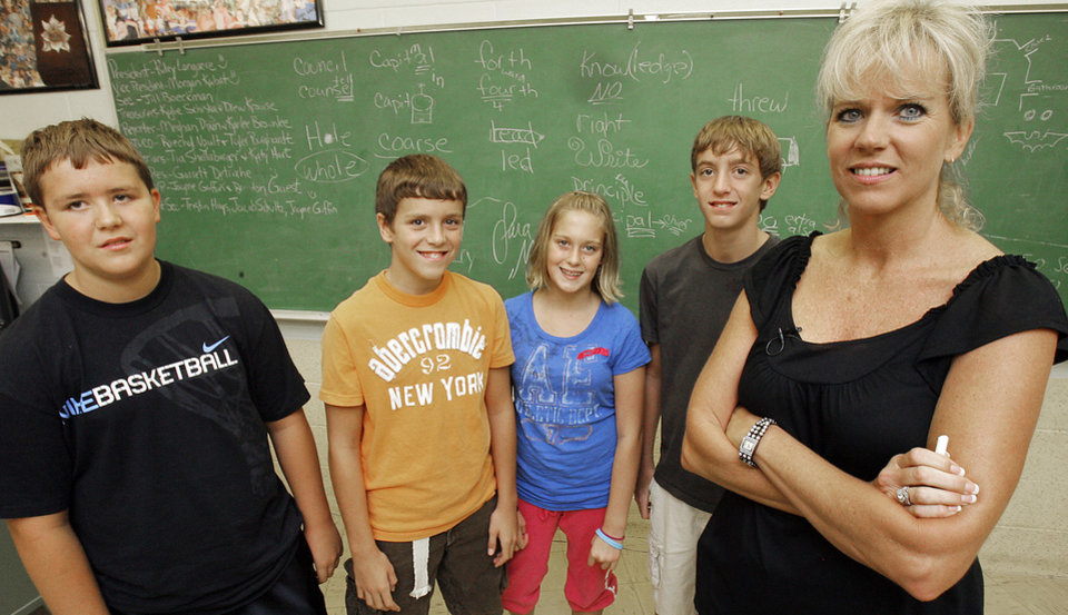 Photo - Ginny Dobrinski's quadruplets, from left, Jamie Dobrinski, Scott Dobrinski, Shelby Dobrinski and Mike Dobrinski that are also her students in Okeene, Tuesday, August, 26, 2008. Photo by David McDaniel, The Oklahoman  ORG XMIT: KOD