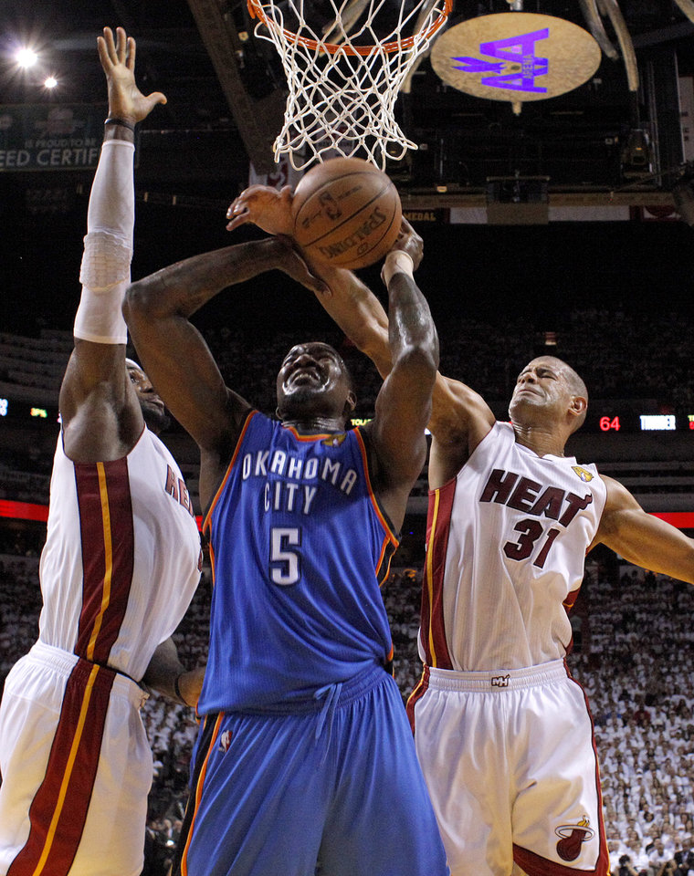 Oklahoma City's Kendrick Perkins (5) goes to the basket between Miami's LeBron James, left, and Shane Battier during Game 3 of the NBA Finals between the Oklahoma City Thunder and the Miami Heat at American Airlines Arena, Sunday, June 17, 2012. Photo by Bryan Terry, The Oklahoman
