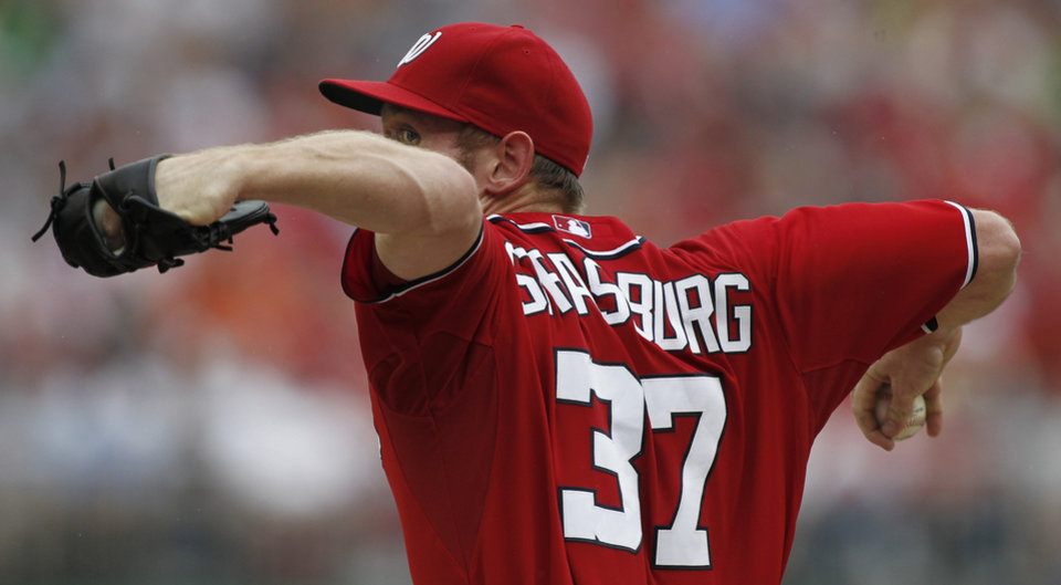 Photo -   Washington Nationals starting pitcher Stephen Strasburg delivers during the second inning of a baseball game with the St. Louis Cardinals at Nationals Park, Sunday, Sept. 2, 2012, in Washington. (AP Photo/Alex Brandon)