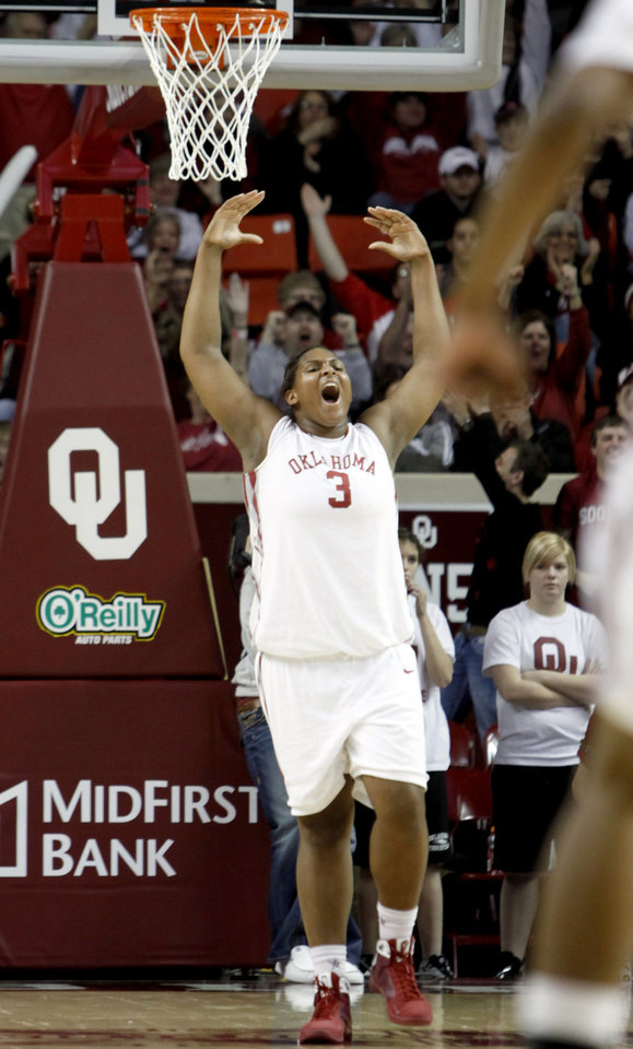 Photo - OU's Courtney Paris (3) celebrates a Sooner score during the women's college basketball game between University of Oklahoma and University of Texas, Sunday, Jan. 25, 2009, at the Lloyd Noble Center in Norman, Okla. PHOTO BY SARAH PHIPPS, THE OKLAHOMAN ORG XMIT: KOD