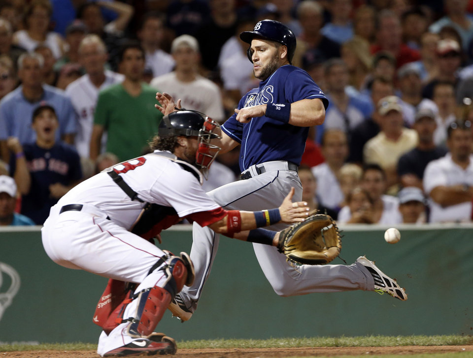 Photo - Tampa Bay Rays' Luke Scott beats the throw into Boston Red Sox catcher Jarrod Saltalamacchia as he scores on a single by James Loney during the eighth inning of a baseball game at Fenway Park in Boston Wednesday, July 24, 2013. (AP Photo/Elise Amendola)