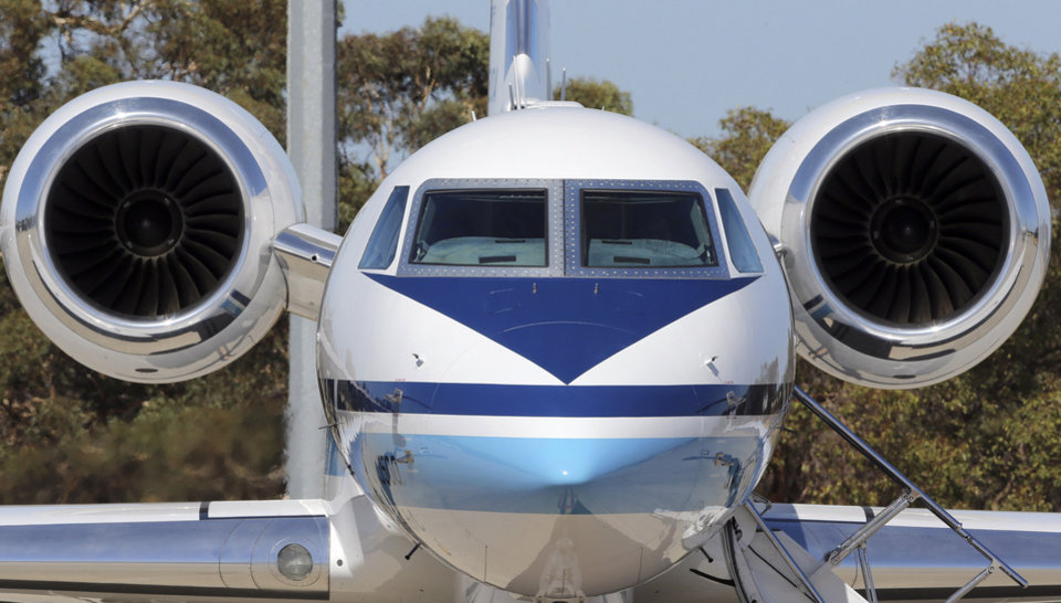Photo - Japan Coast Guard's Gulfstream V aircraft sits on the tarmac at RAAF Base Peace in Perth, Australia, Wednesday, April 2, 2014. Ten planes and nine ships resume the search for the missing Malaysia Airlines flight MH370 in the southern Indian Ocean. (AP Photo/Rob Griffith)