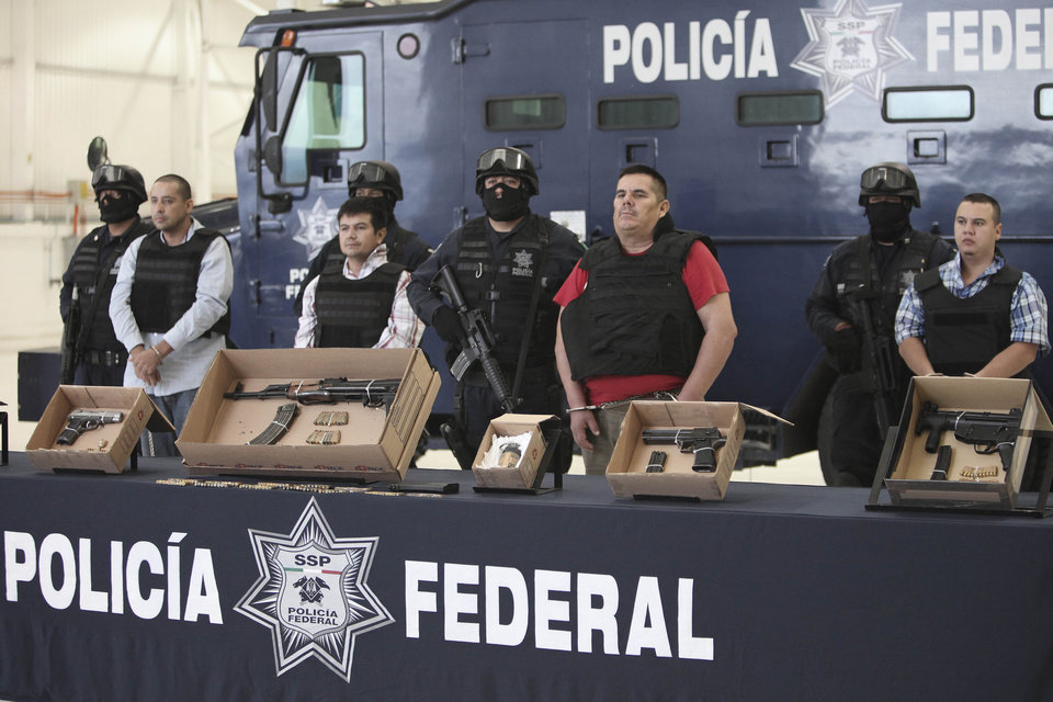 "Jose de Jesus Mendez Vargas, aka, ""El Chango"" or ""The Monkey,"" alleged leader of Mexican La Familia drug cartel, looks on during his presentation to the press next to other alleged members of the drug organization in Mexico City, Wednesday, June 22, 2011. Mendez was arrested at a federal police checkpoint in the Mexican central state of Aguascalientes Tuesday, without confrontation or casualties according to authorities. The government had offered a $2.5 million reward for his capture. (AP Photo/Miguel Tovar)"