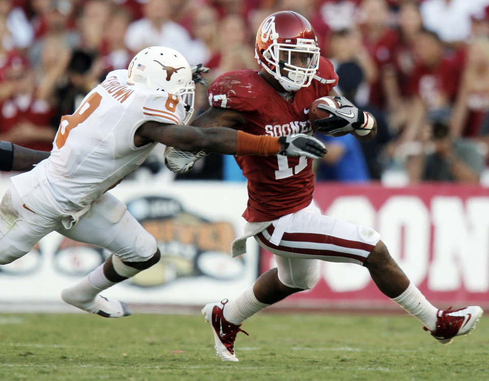Photo - OU's Mossis Madu (17) tries to get away from Chykie Brown (8) of Texas during the Red River Rivalry college football game between the University of Oklahoma Sooners (OU) and the University of Texas Longhorns (UT) at the Cotton Bowl on Saturday, Oct. 2, 2010, in Dallas, Texas. OU won, 28-20. Photo by Nate Billings, The Oklahoman
