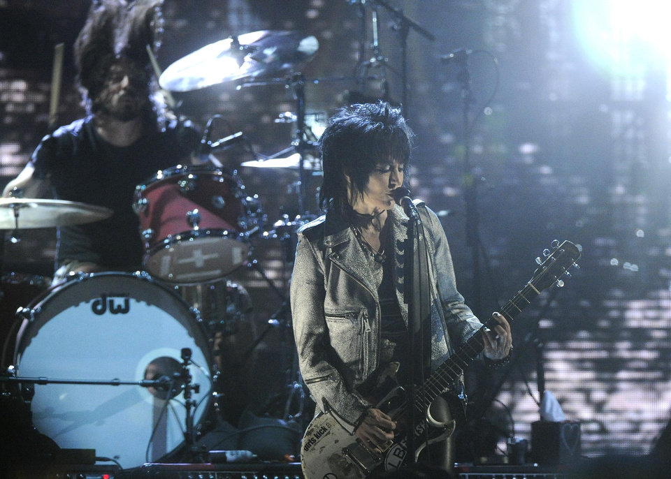 Photo - Hall of Fame Inductee Dave Grohl and Joan Jett perform at the 2014 Rock and Roll Hall of Fame Induction Ceremony on Thursday, April, 10, 2014 in New York. (Photo by Charles Sykes/Invision/AP)