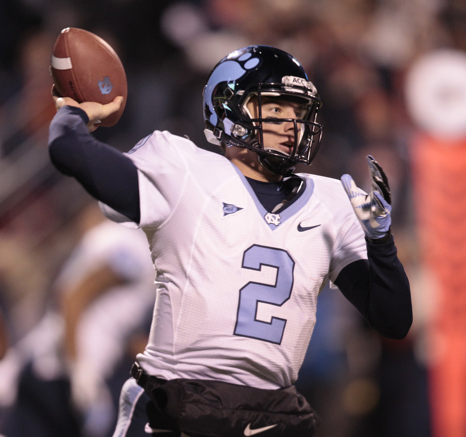 Photo -   North Carolina quarterback Bryn Renner (2) tosses a pass during the first half of an NCAA college football game at Scott stadium Thursday, Nov. 15, 2012 in Charlottesville, VA . North Carolina won the game 37-13. (AP Photo/Steve Helber)