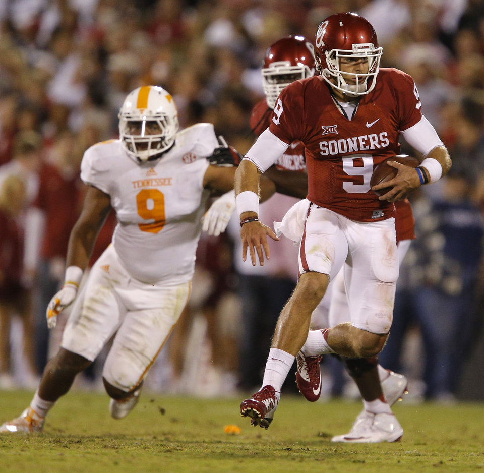 Photo - Oklahoma's Trevor Knight (9) runs during a college football game between the University of Oklahoma Sooners (OU) and the Tennessee Volunteers at Gaylord Family-Oklahoma Memorial Stadium in Norman, Okla., on Saturday, Sept. 13, 2014. Photo by Bryan Terry, The Oklahoman
