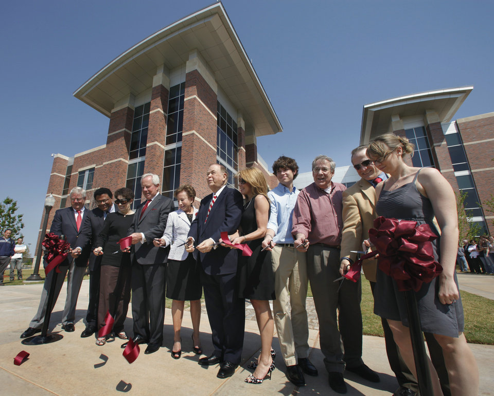 Photo - RIBBON-CUTTING / DEDICATE / DEDICATED / OU / CHARLES STEPHENSON: Cutting the ribbon at the dedication of the Stephenson Life Sciences Research Center on the University of Oklahoma campus are Tom Maxwell, George Richter-Addo, Molly Boren, Charles and Peggy Stephenson, President David Boren, the Stephensons' daughter and grandson Cindy and Andrew Fields, Dr. Bruce Roe, artist Mike Wimmer, and student Christine Theodore on Wednesday, April 13, 2011, in Norman, Okla.   Photo by Steve Sisney, The Oklahoman ORG XMIT: KOD